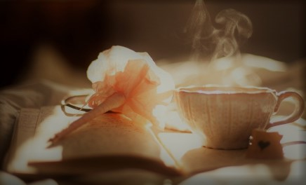 steaming tea and an open book