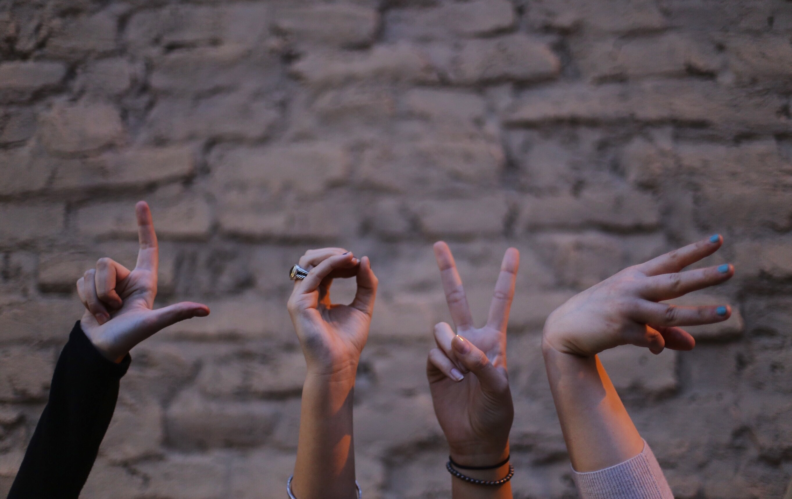 hands spelling l-o-v-e